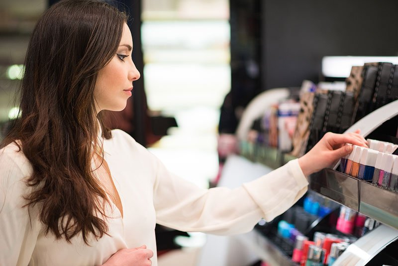 Woman shopping for hypoallergenic makeup