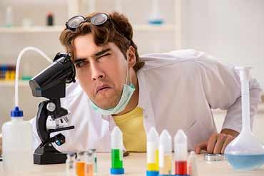 Man looking through microscope